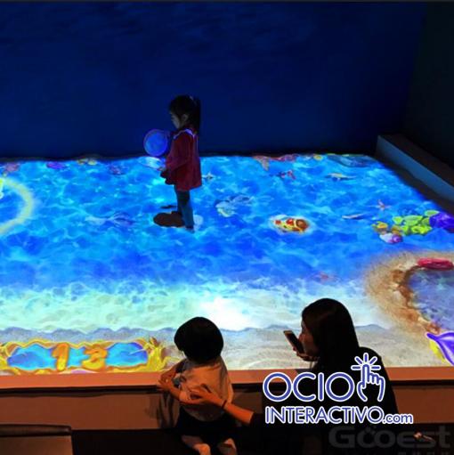Playa con arena interactiva